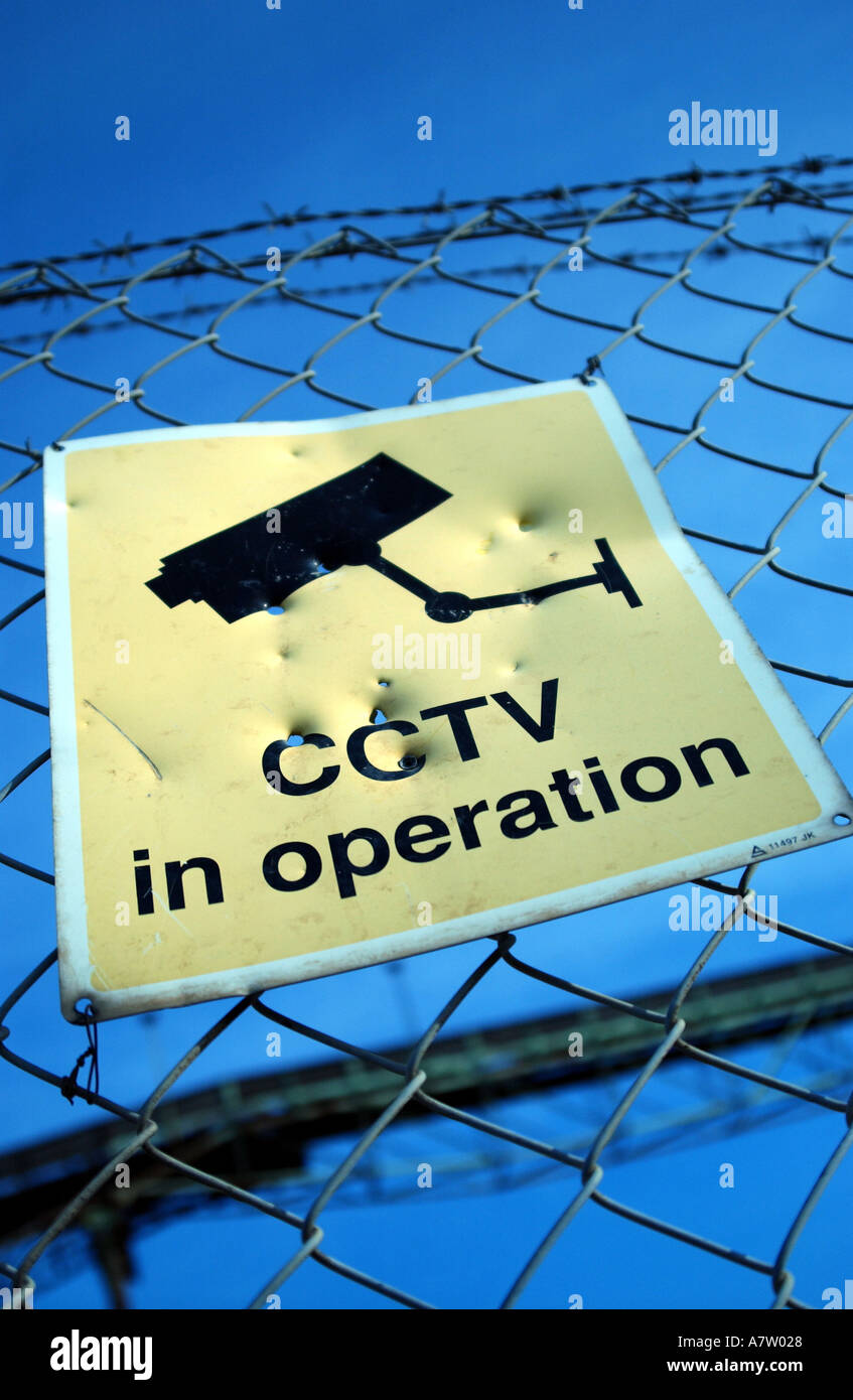 a sign warning people that premises is protected by cctv - Stock Image