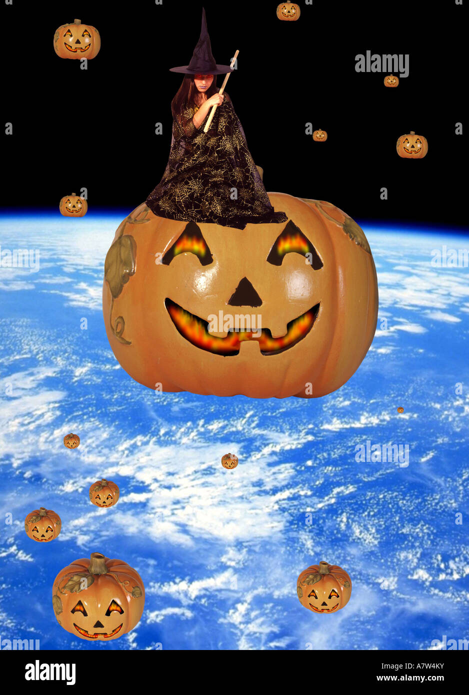 Halloween pumpkins orbiting the earth, young witch sitting on one - Stock Image
