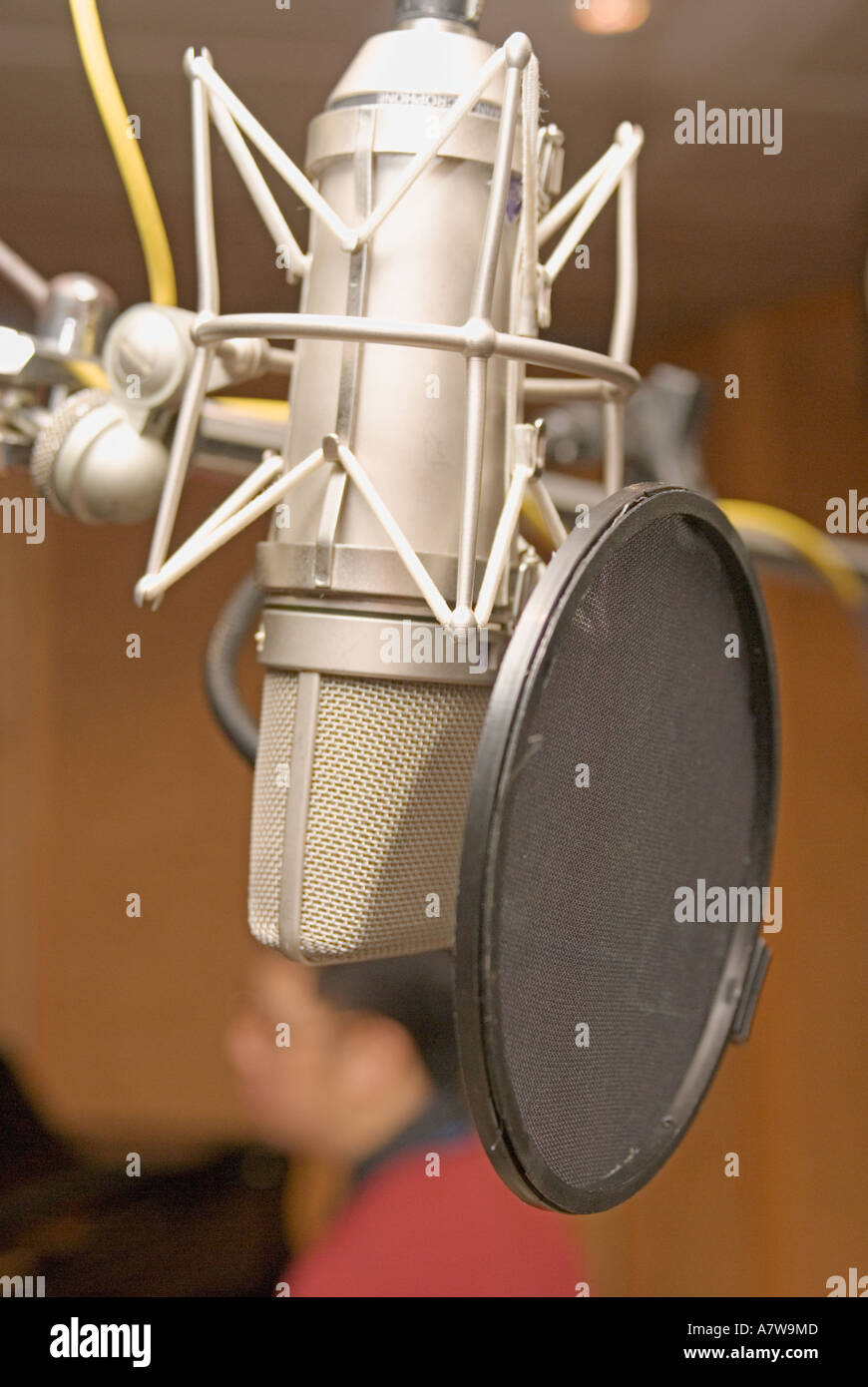 Close up of Newman u87 tube condenser mic microphone in music recording studio - Stock Image