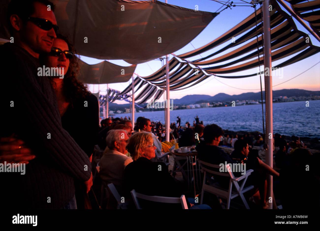Couple in cafe del Mar Sant Antoni del Portmany Ibiza Balearic islands Spain - Stock Image