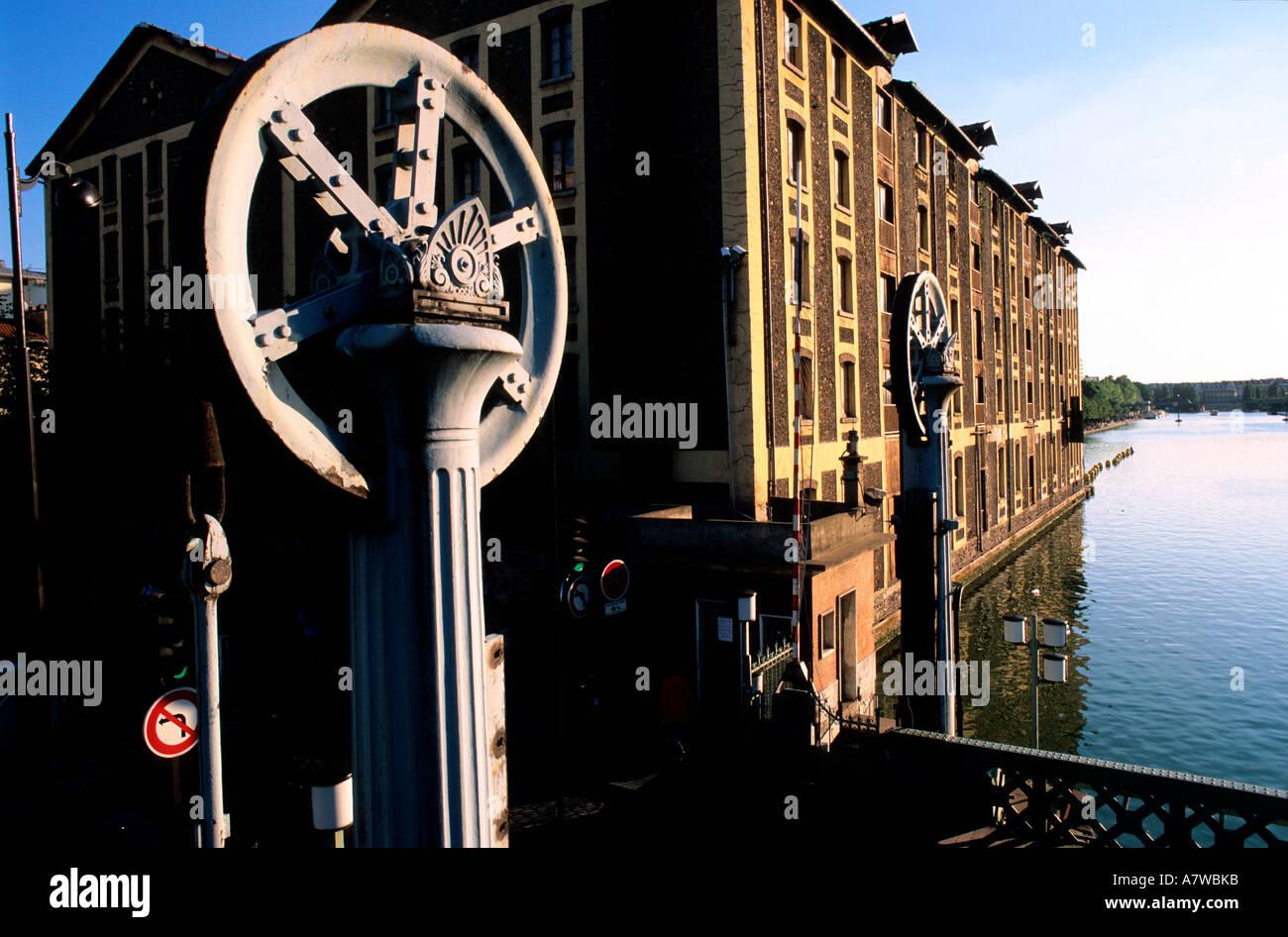 France, Paris, drawbridge spanning the Ourcq canal - Stock Image