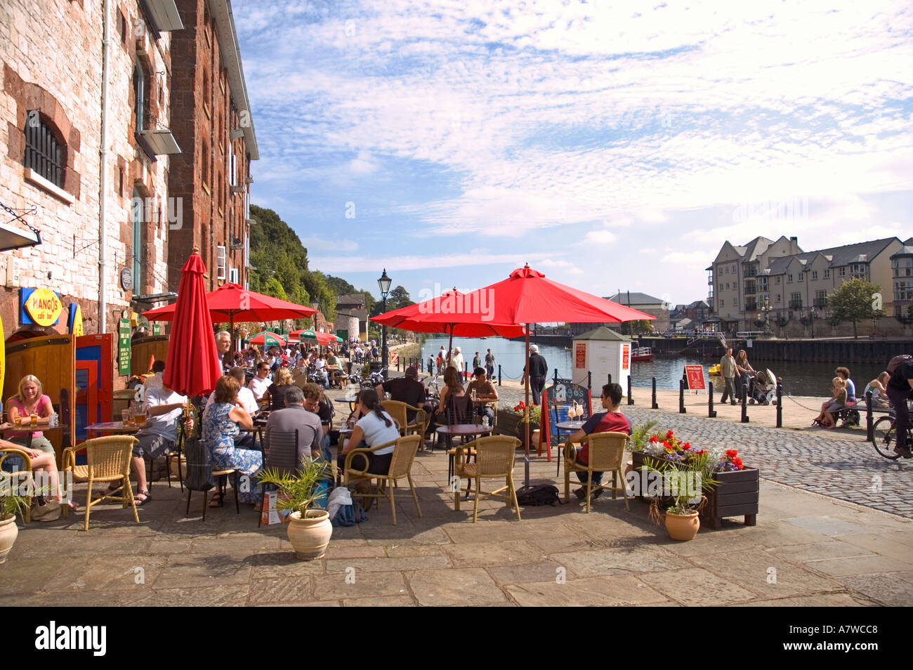 people relaxing at a riverside cafe at the quay exeter devon gb - Stock Image