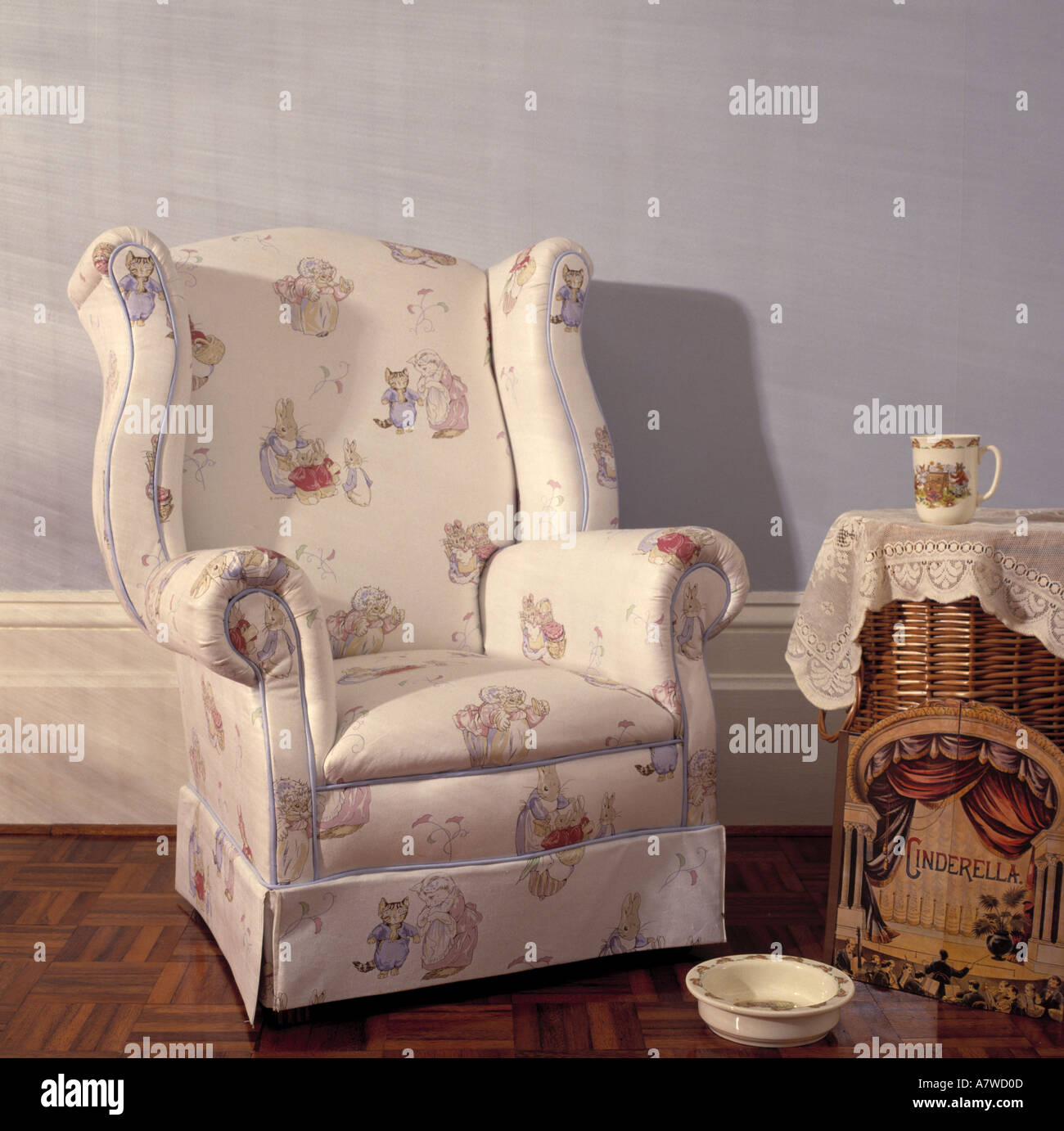 Close-up of Beatrix Potter fabric upholstered armchair - Stock Image