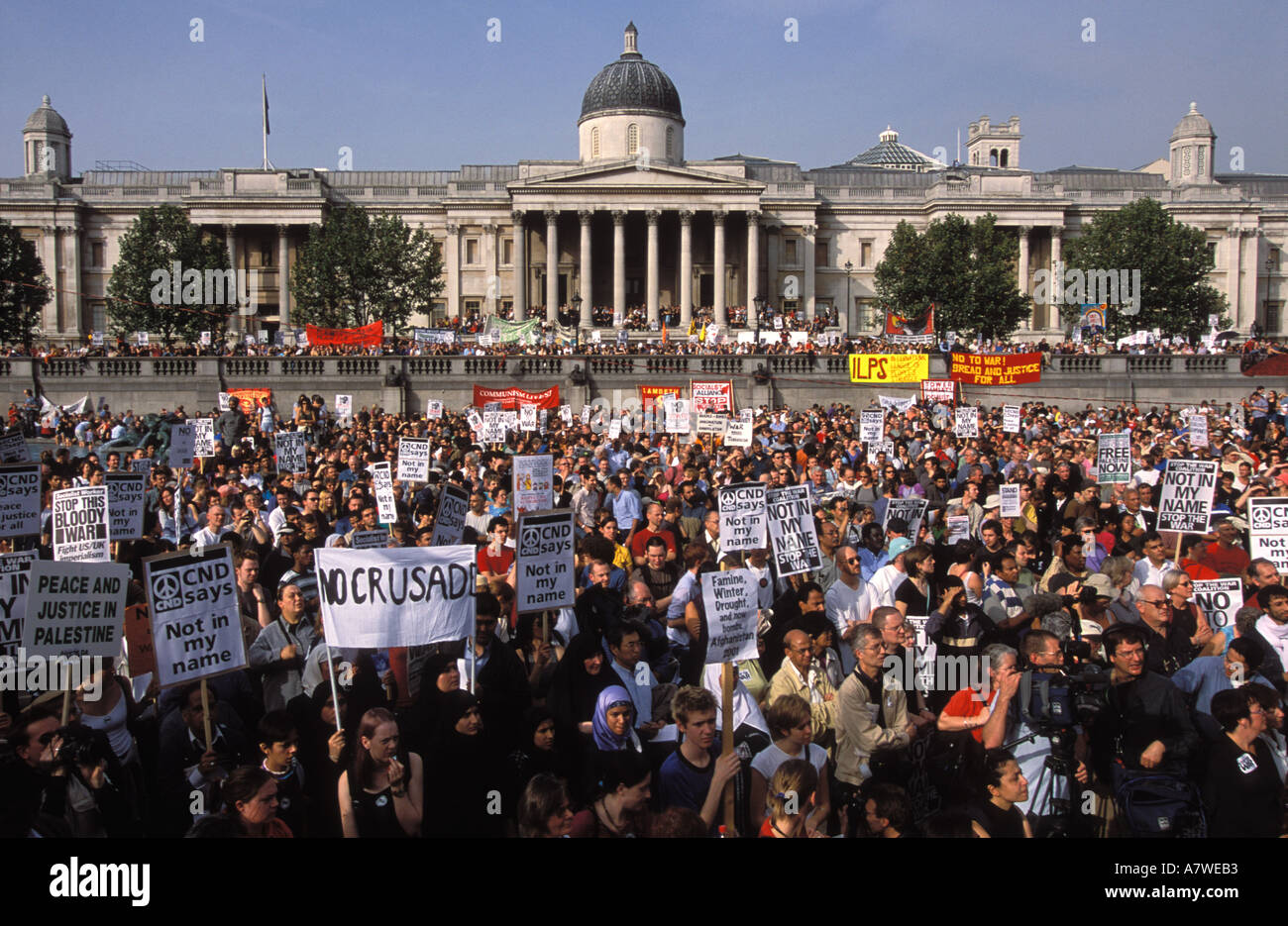 March and rally in Trafalgar Square, London, UK, against the bombing of Afghanistan, October 2001. - Stock Image