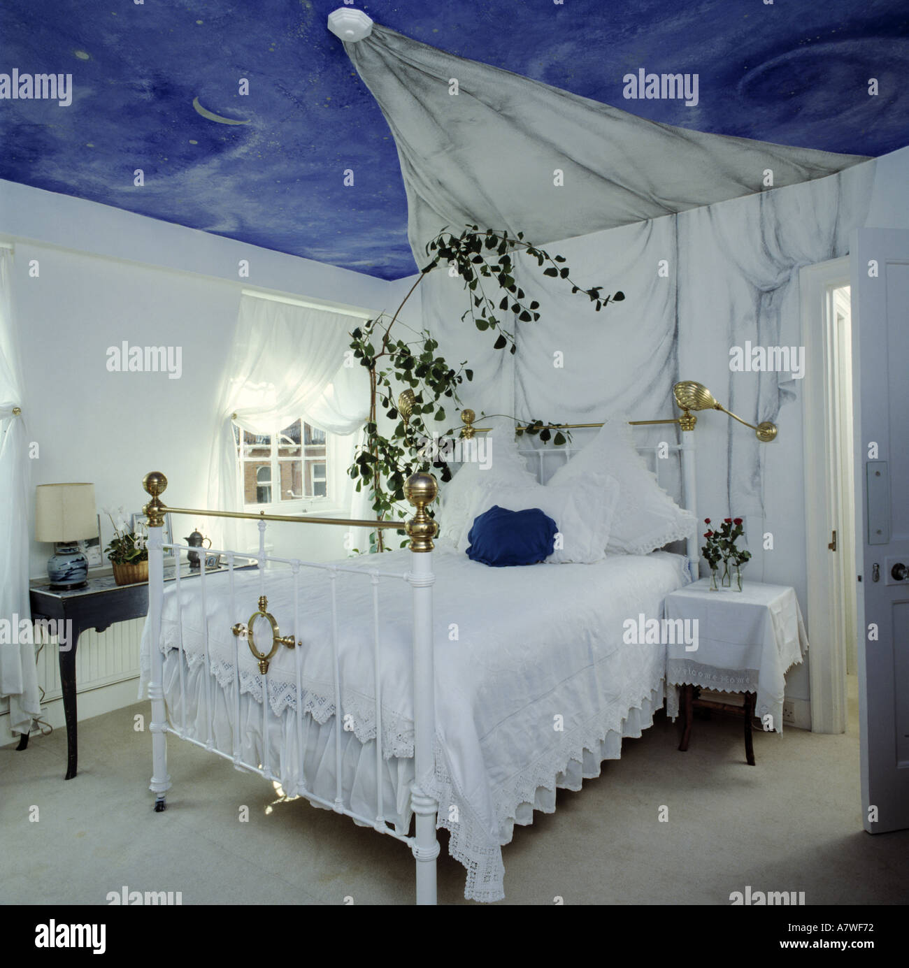 Blue Night Sky Mural Painted On Ceiling Above Bed With False Drapes
