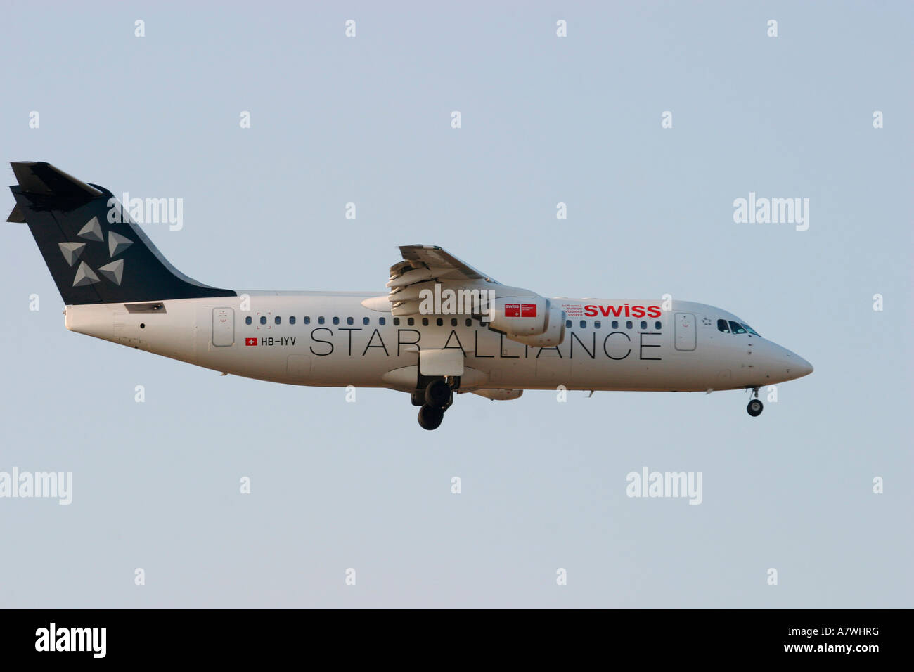 Airplane British Aerospace BAe 146-300 of the Swiss Star Alliance landing - Stock Image