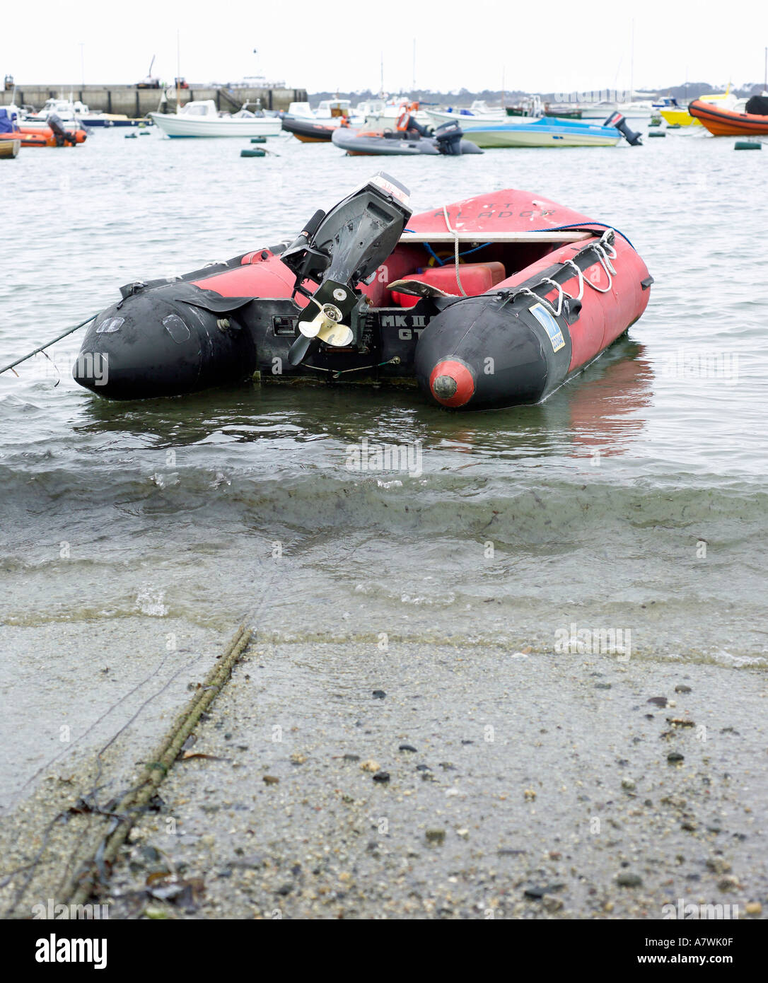 dingy with outboard motor moored in St marys hourbour Isles of Scilly - Stock Image