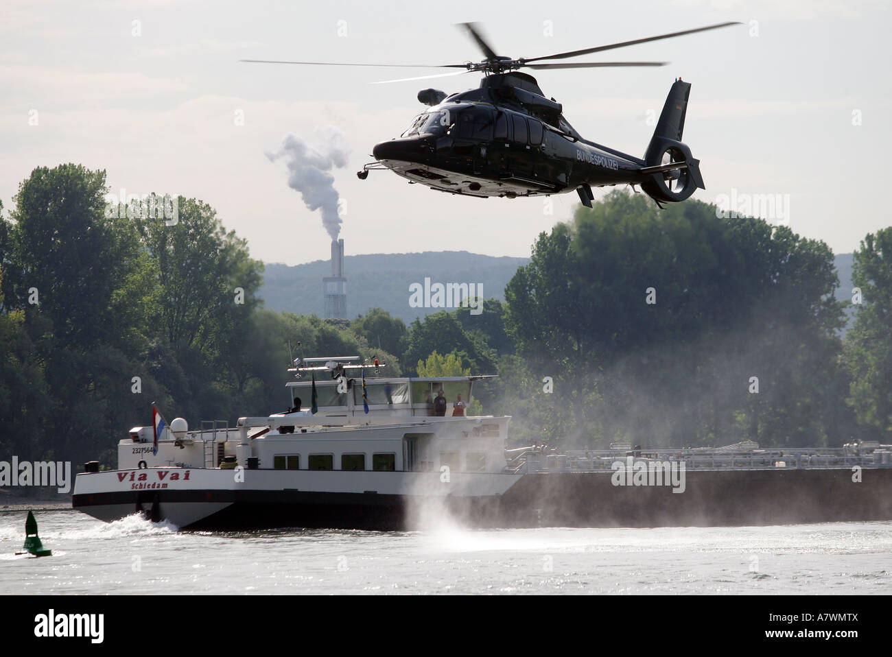 German Police helicopter exercises saving persons out of a river Stock Photo