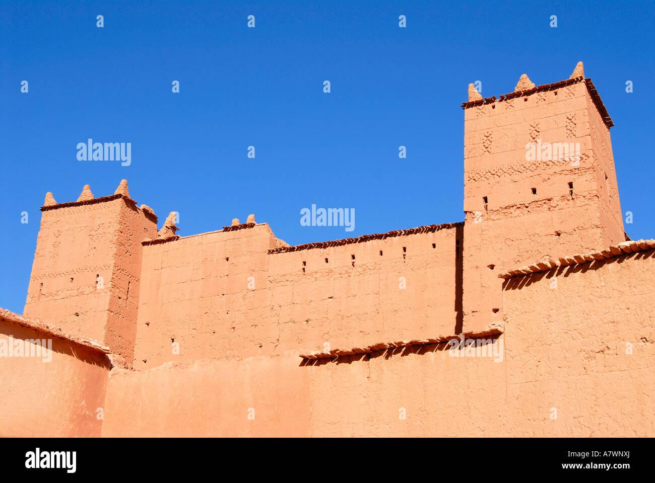 Reddish walls made of clay ksar kasbah Ait-Youl Morocco - Stock Image