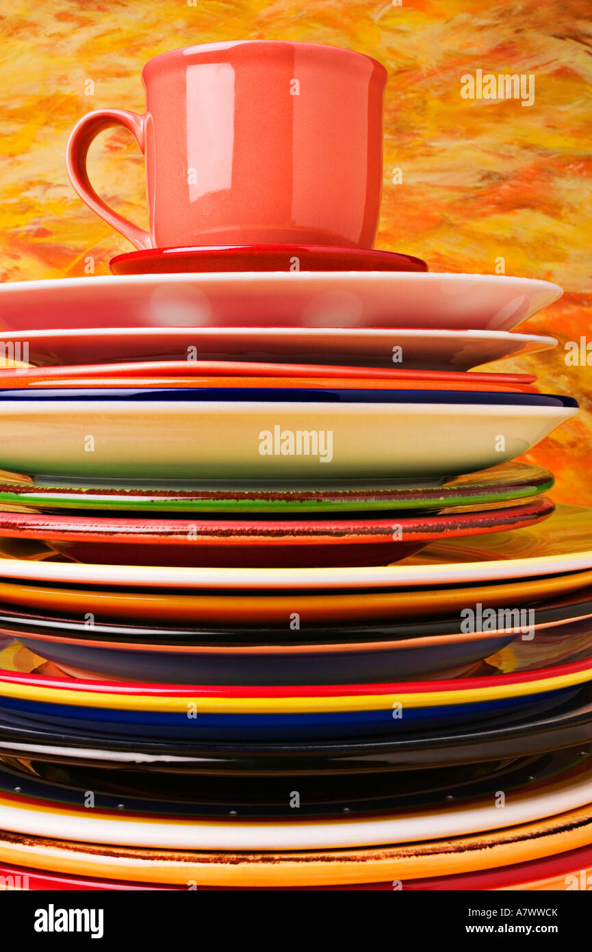 Pile of plates with cup and saucer - Stock Image