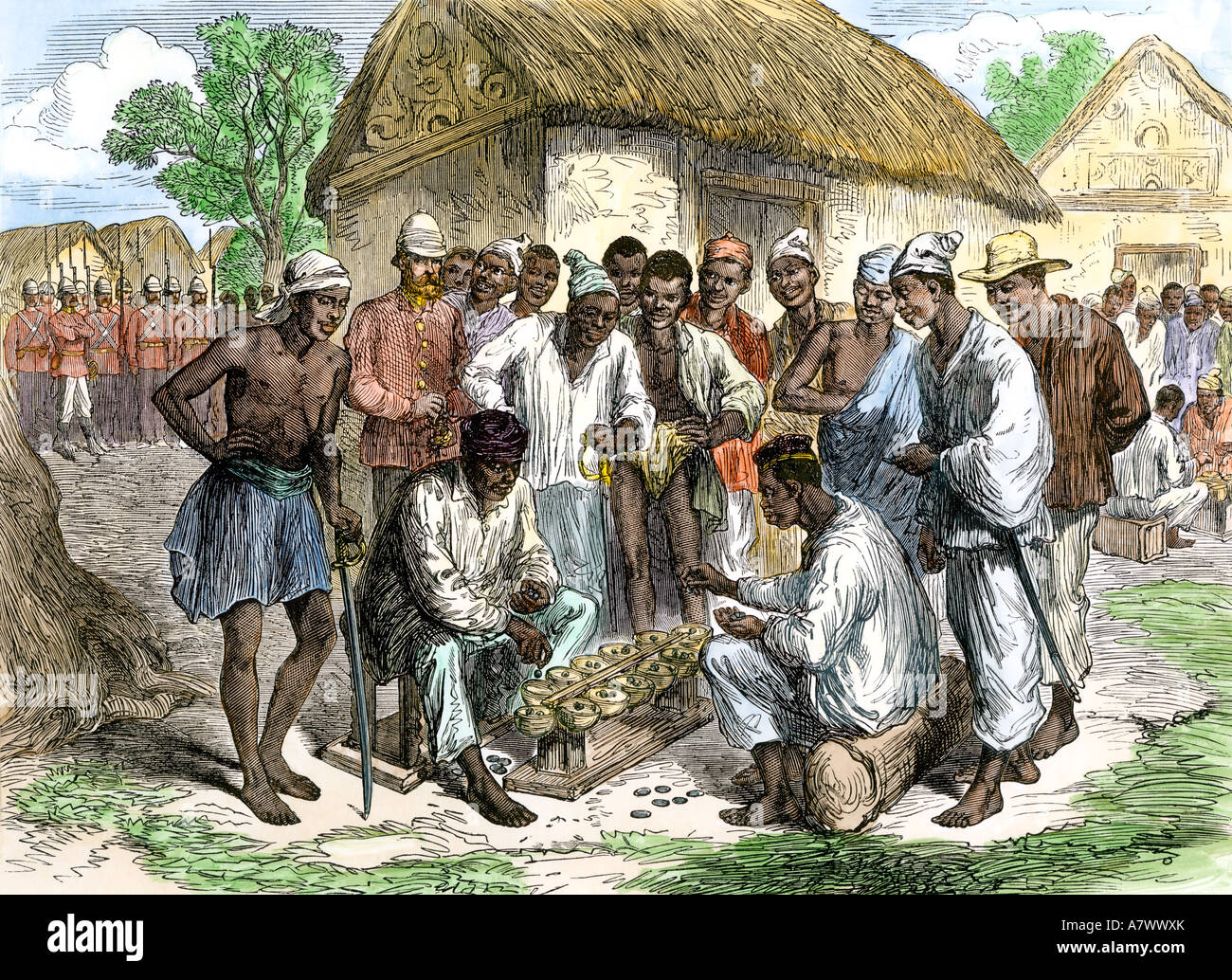 Native soldiers playing warry in Ashanti Colony Africa 1870s. Hand-colored woodcut - Stock Image