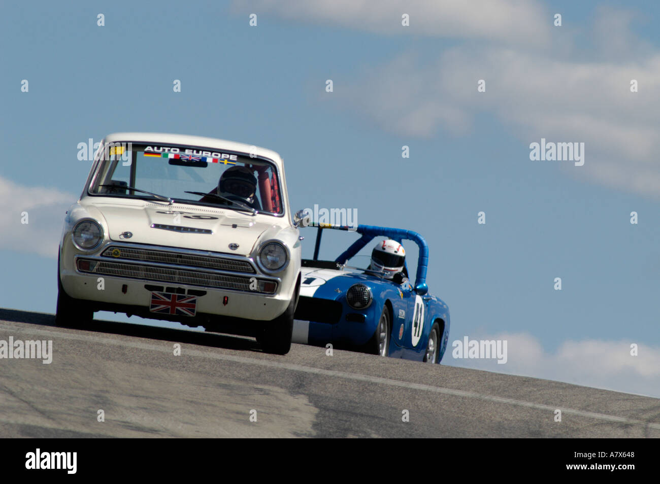 Don Heth in his 1966 Cortina Lotus followed by Ken Holley in his 1965 Sprite at the Vintage Grand Prix Au Grattan Stock Photo