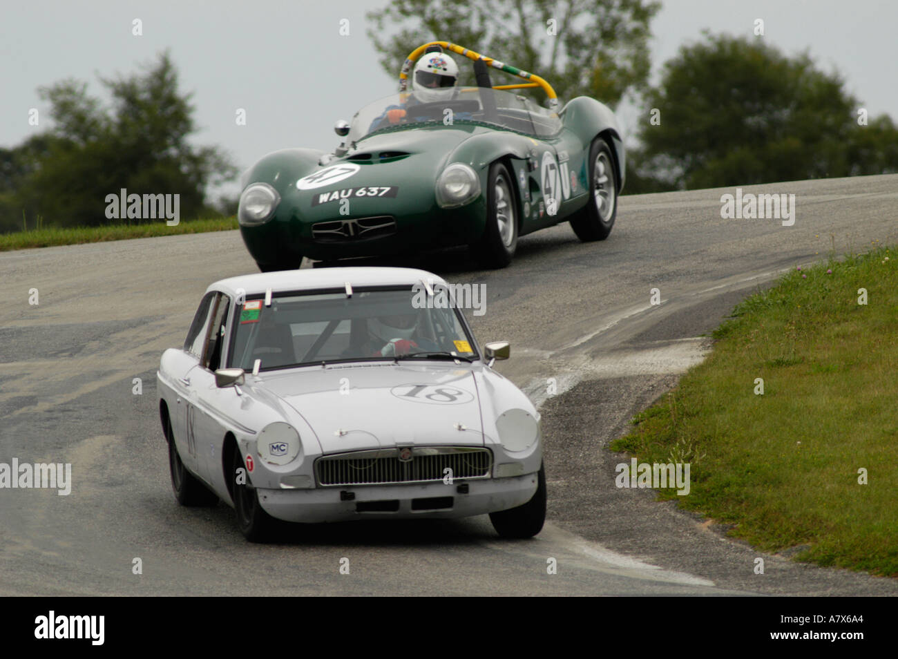 John Golanty in his 1973 MGB GT followed by Bob Wismer in his 1959 Tornado Thunderbolt at the Vintage Grand Prix Au Grattan - Stock Image