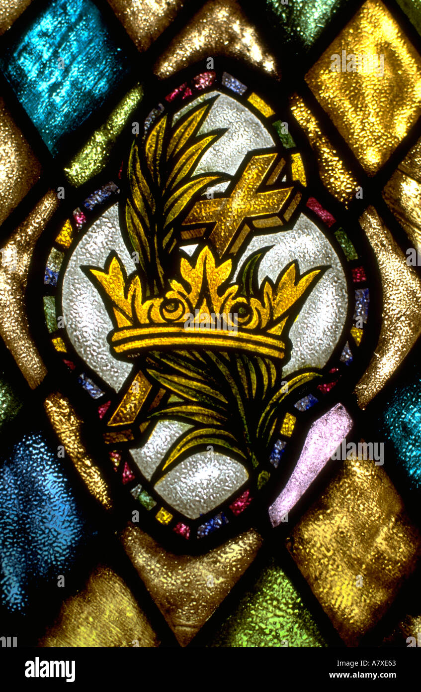 Crown palm branch and cross stained glass window. WesternSprings Illinois USA - Stock Image