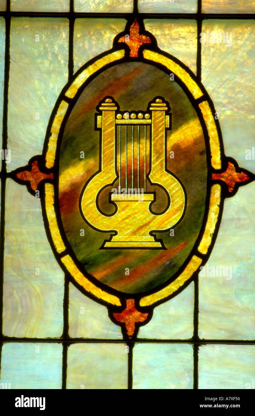 Lyre or harp on stained glass window. Minneapolis Minnesota USA - Stock Image