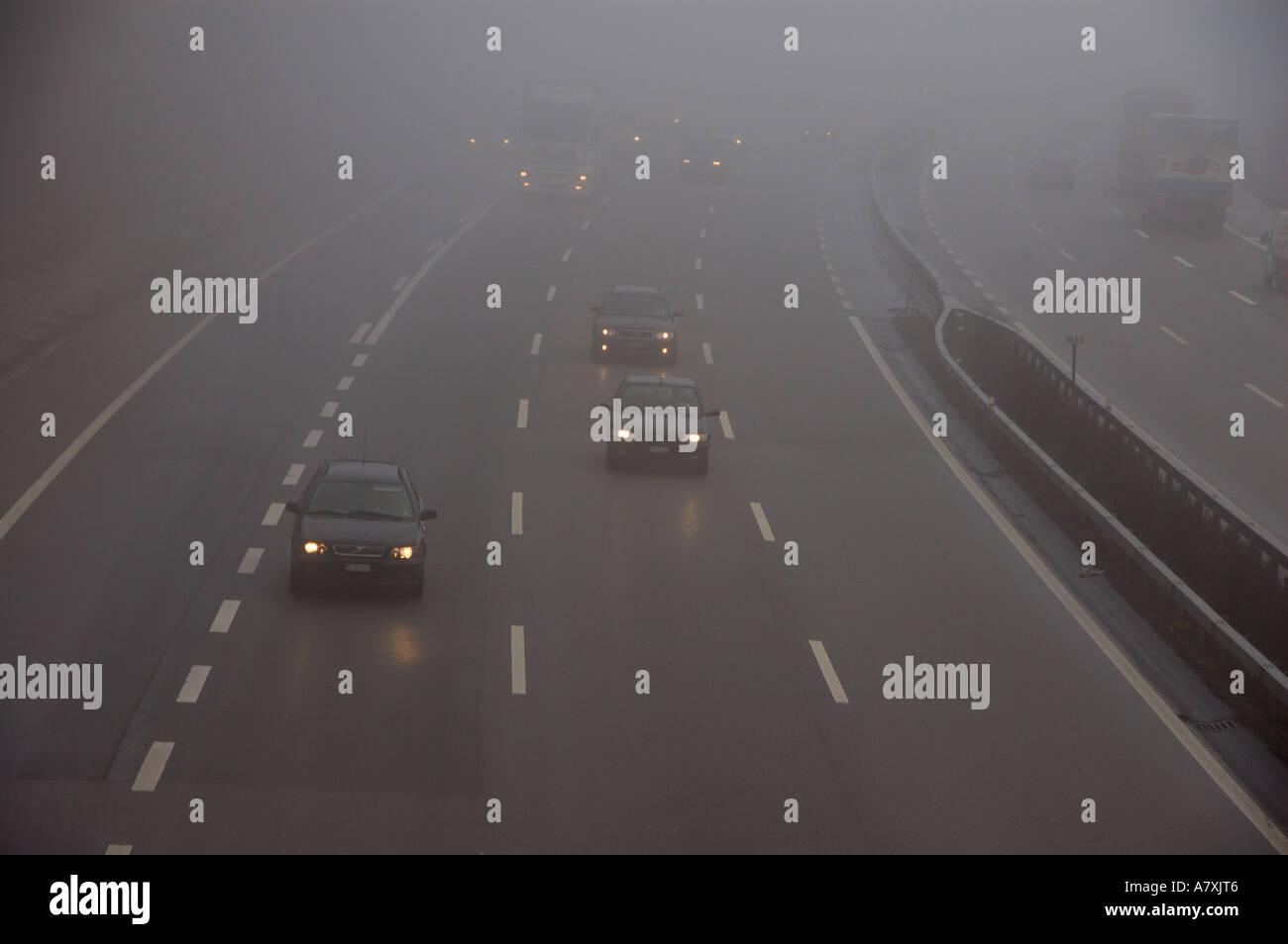 fog on motor highway in switzerland. (c) by uli nusko, ch-3012 bern. Stock Photo
