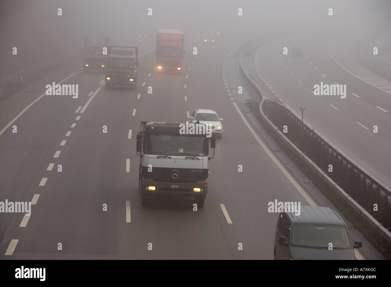 fog on motor highway in switzerland. (c) by uli nusko, ch-3012 bern. Stock Photo