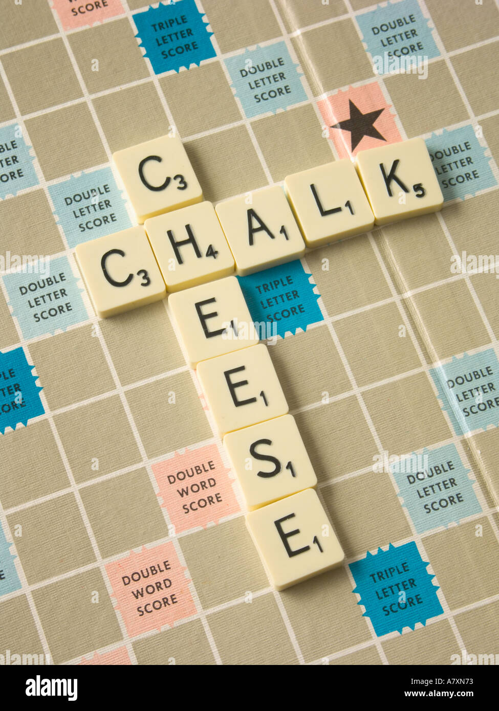 "Scrabble tiles spelling the phrase ""Chalk and Cheese"" Stock Photo"