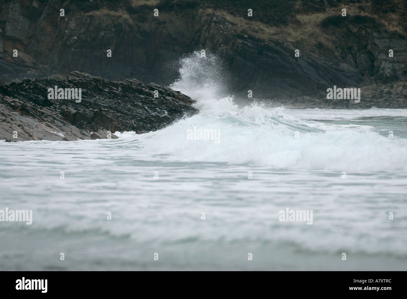 waves crash on rocks in stormy sea on Tra Na Rossan beach near Downings County Donegal Republic of Ireland - Stock Image