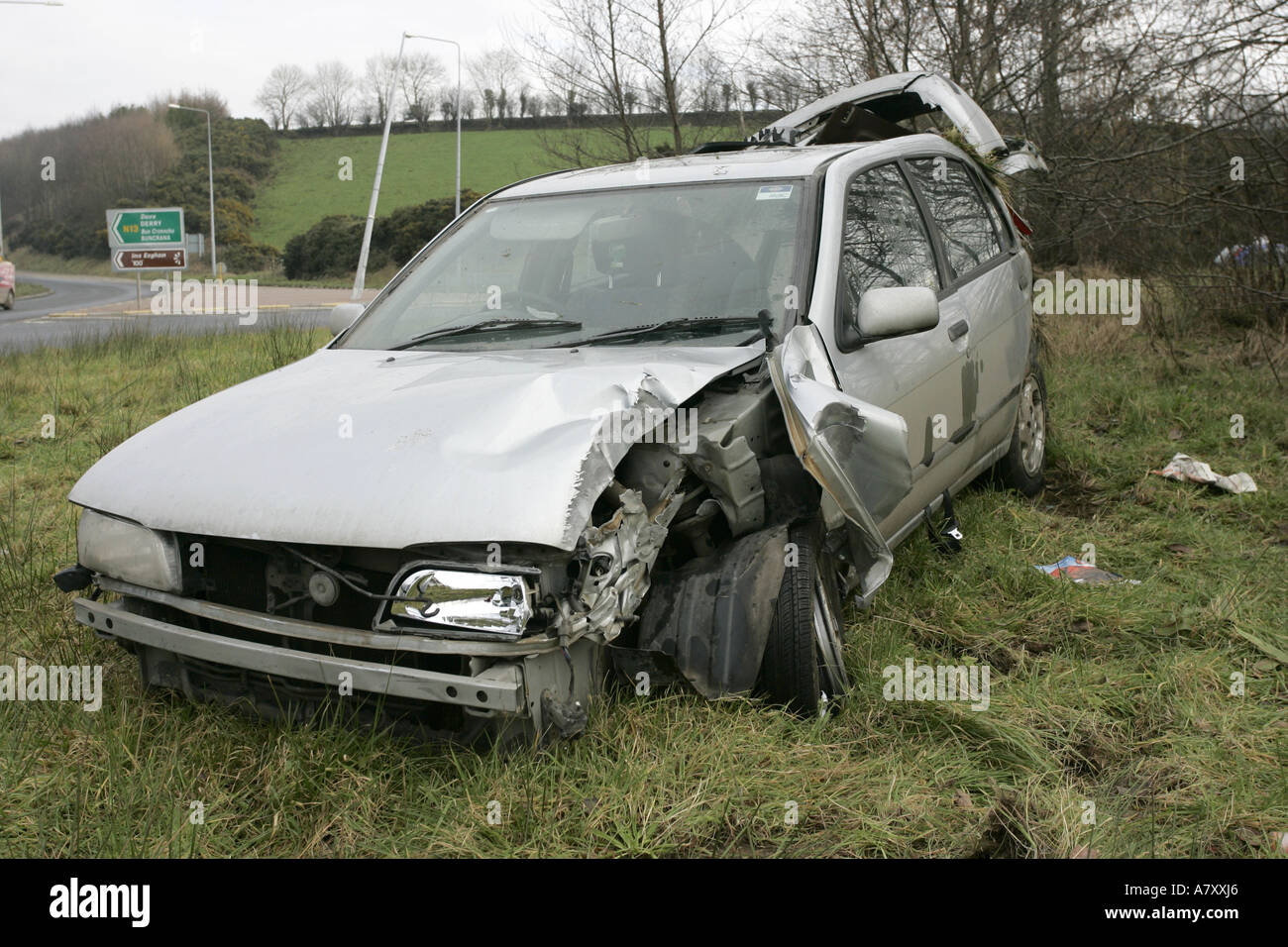 road traffic accident with crashed car on a roundabout outside Letterkenny County Donegal Republic of Ireland - Stock Image