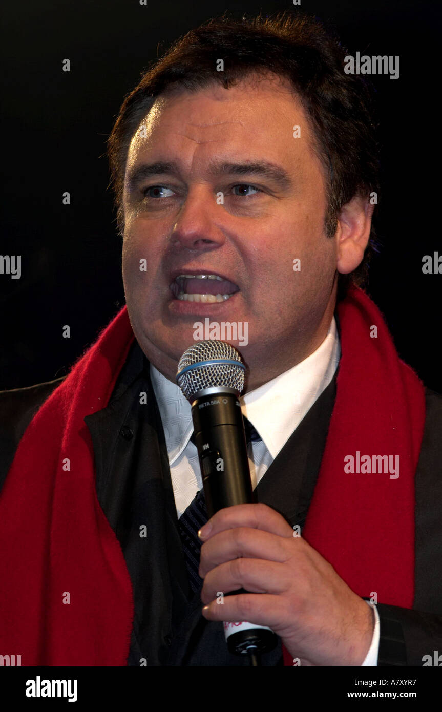 Tv Presenter Eamonn Holmes With Microphone On Stage With Black Coat And Red Scarf Belfast Northern Ireland