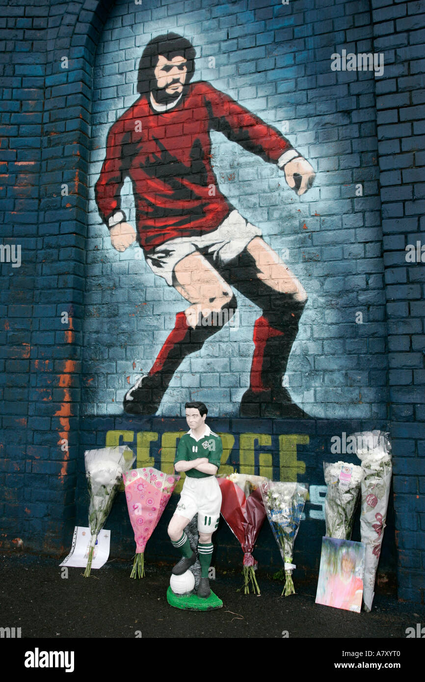 Fan tributes left at the George Best mural at Northern Ireland football ground Windsor Park before George Bests funeral - Stock Image