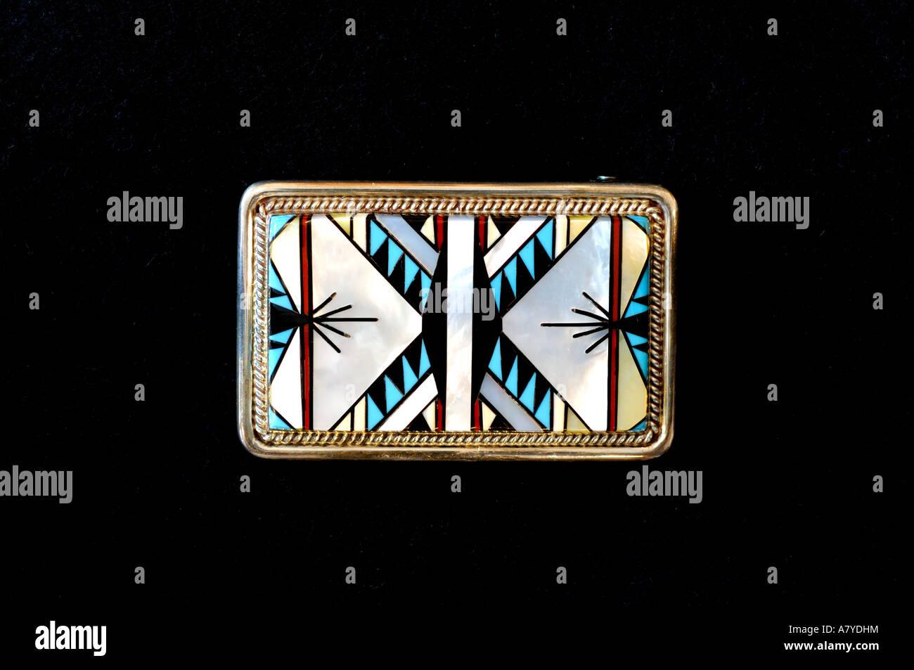 Southwest, American Indian art & handicrafts. Classic Zuni inlay belt buckle, blanket pattern. Property release. Stock Photo