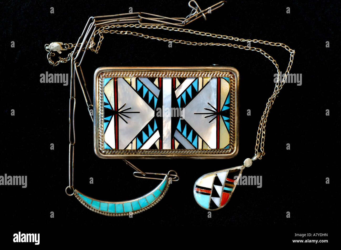 Southwest, American Indian art & handicrafts. Classic Zuni inlay jewelry. Silver belt buckle, multi-stone necklaces. Stock Photo