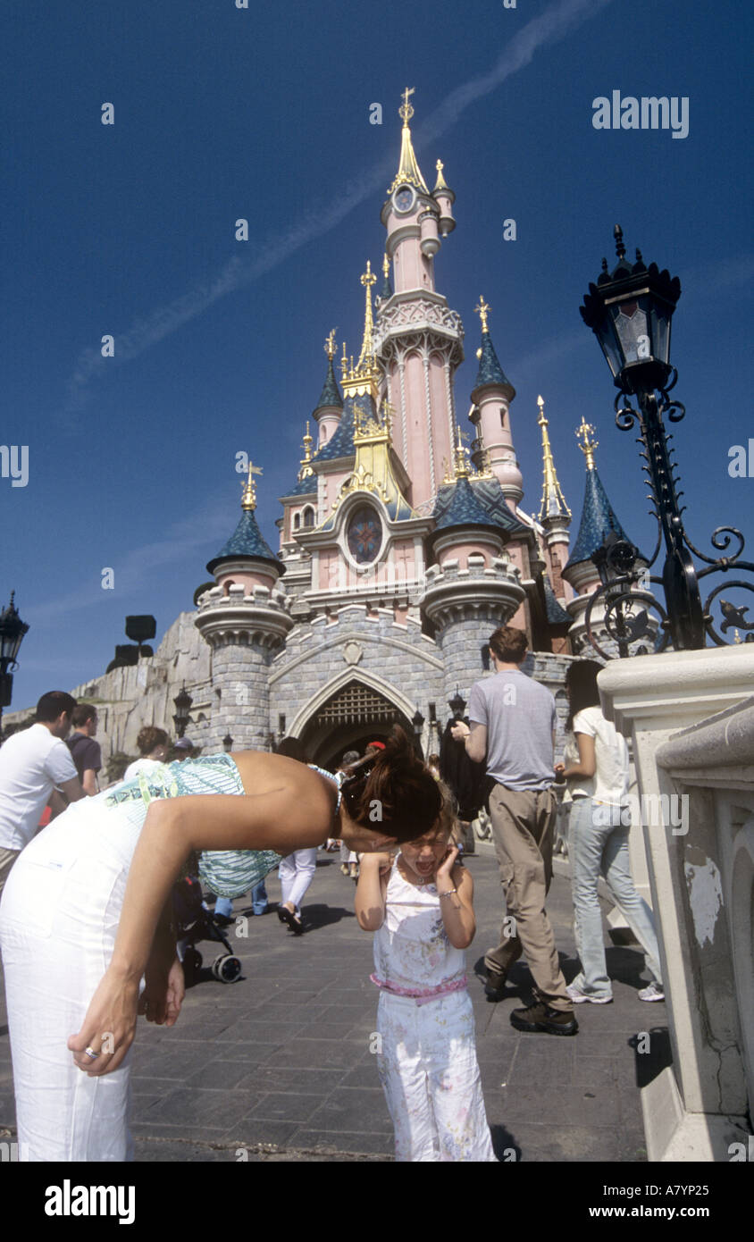Child having a temper tantrum at disneyland paris - Stock Image