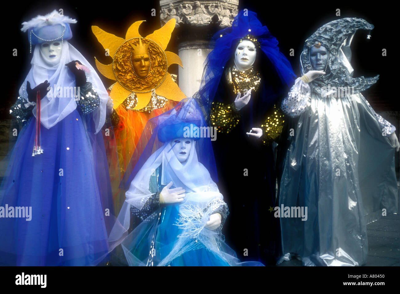 Group of five brightly coloured carnival revellers Earth Wind Fire Water Stars etc Venice carnival Venice Italy - Stock Image