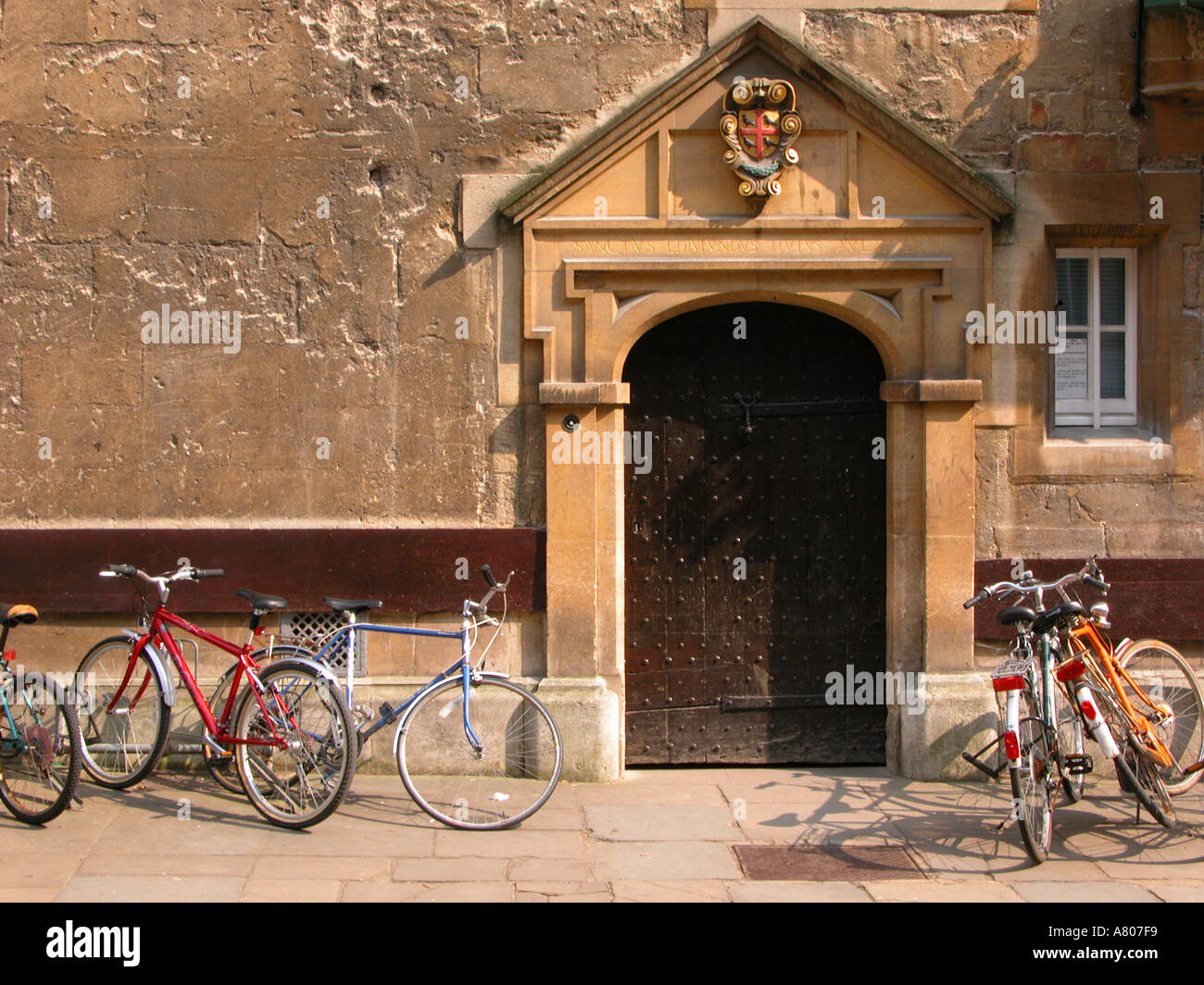Bicycles parked in front of St Edmund Hall Entrance Oxford University - Stock Image