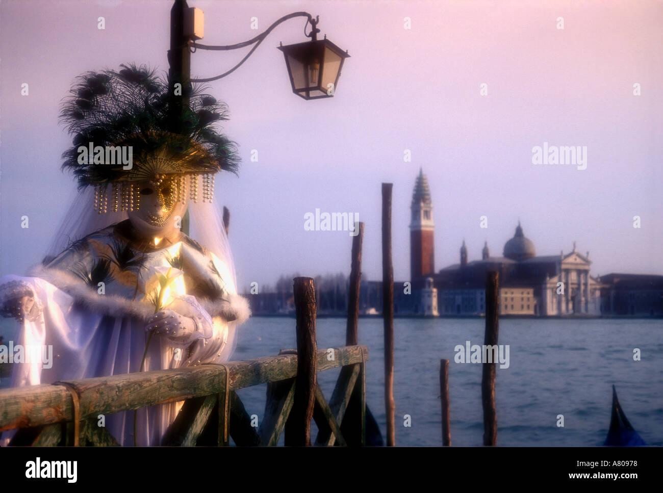 Carnival goer in Oriental costume at the annual Venice carnival Italy - Stock Image