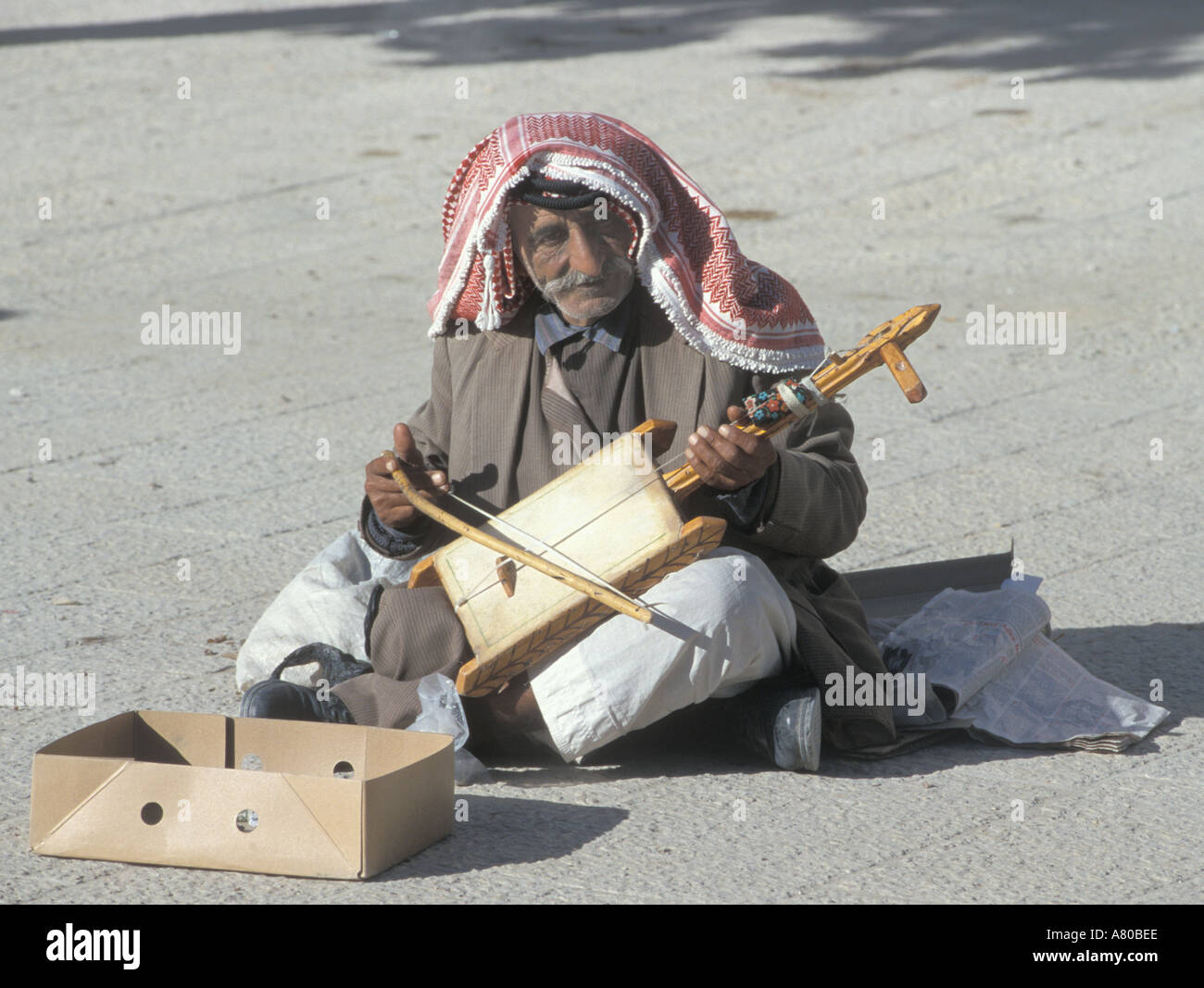 Palestinian man busking playing traditional Rubarba Rabala with his foot in Manger Square Bethlehem Palestinian National Authori - Stock Image