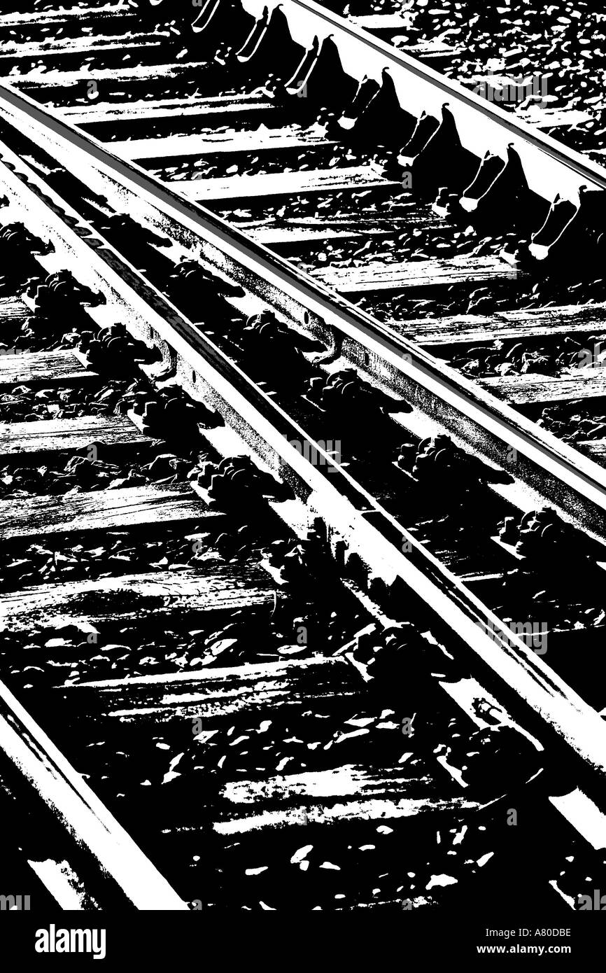 Rail tracks converging from two into one - Stock Image