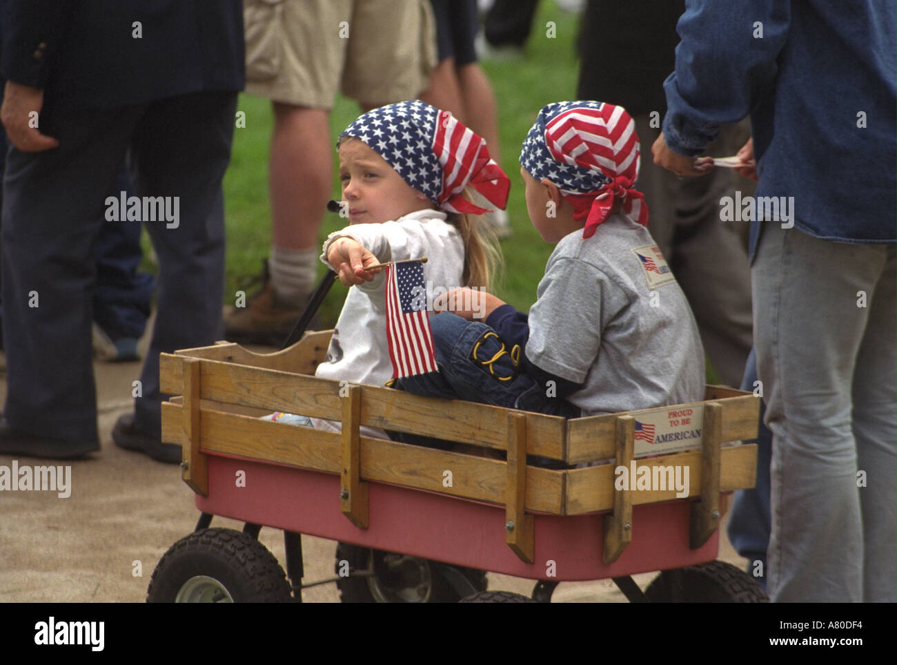 Children in wagon flag kerchiefs at Minnesota Remembers Memorial for 9/11 victims at state capitol. St Paul Minnesota MN USA - Stock Image