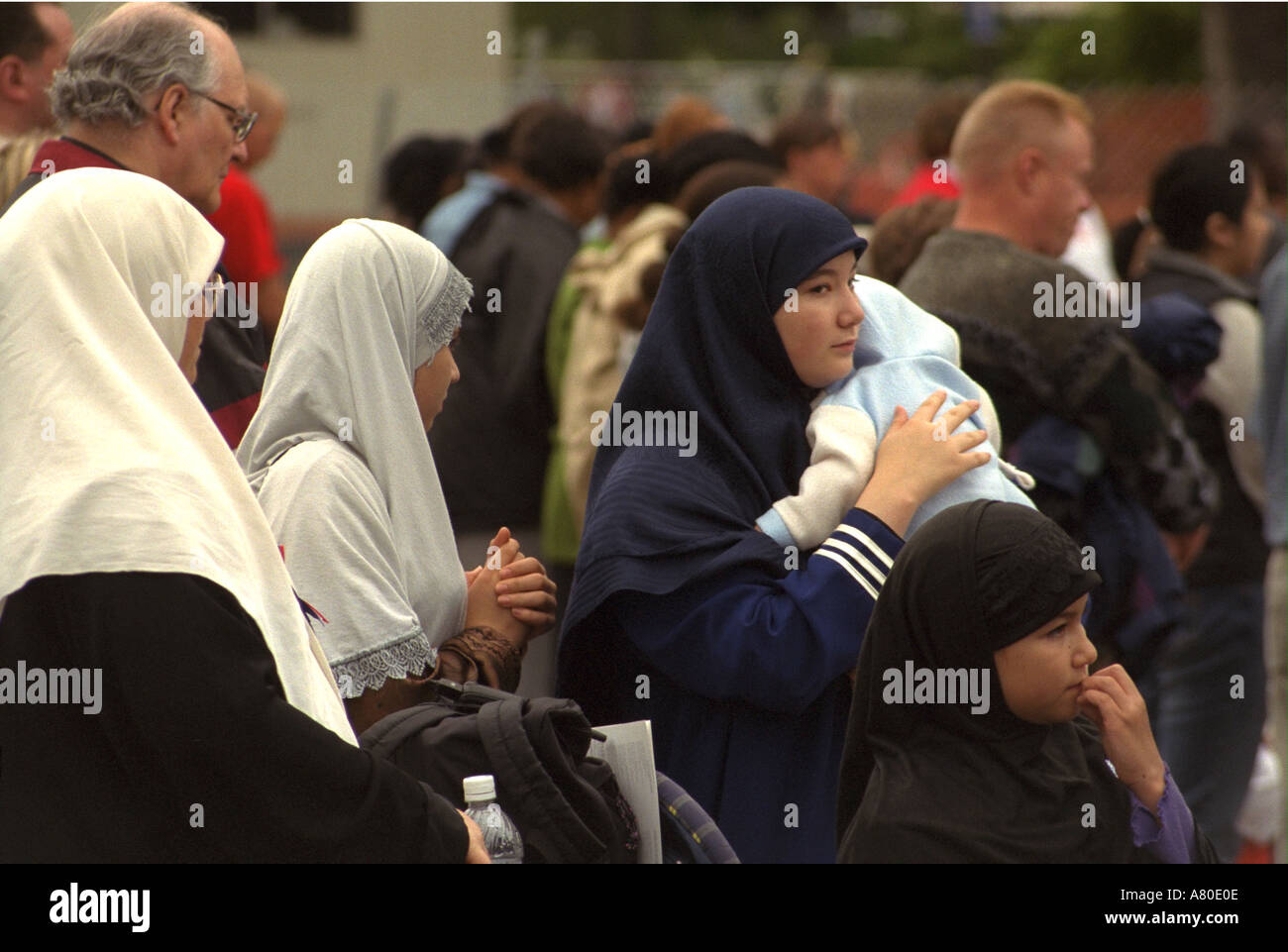 Muslim mom baby family headscarf at Minnesota Remembers Memorial Service at capitol for 9/11 victims. St Paul Minnesota MN USA - Stock Image