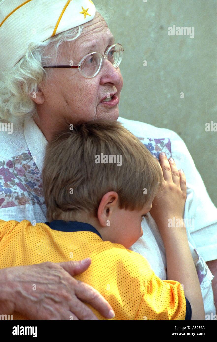 600ac9b2be518 World War II nurse holding grandson age 8 at Memorial Day service. St Paul  Minnesota