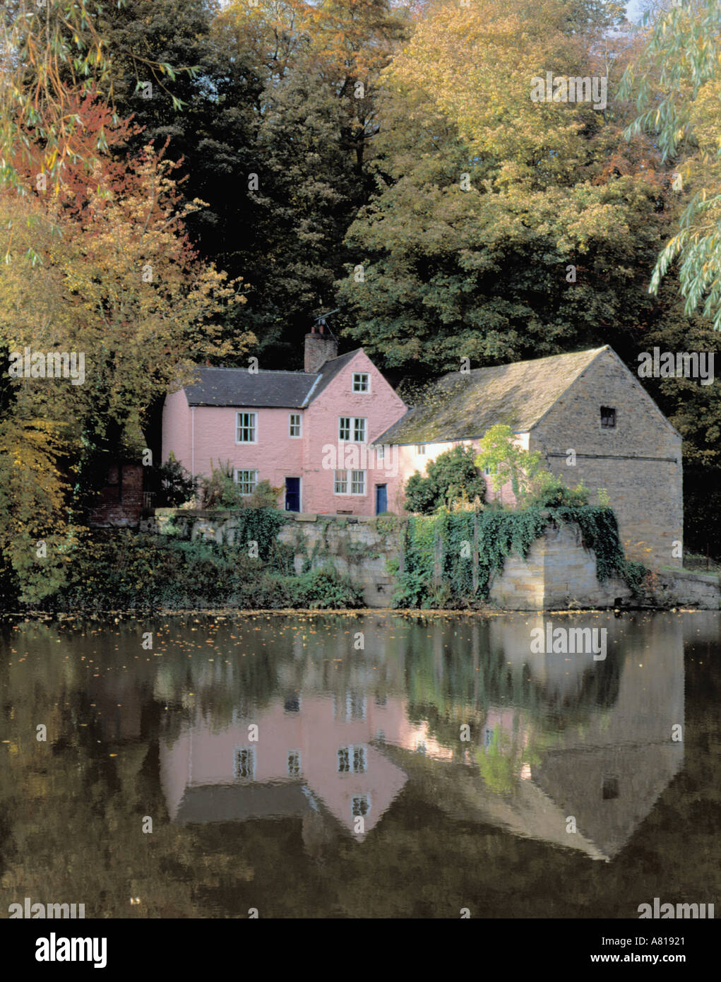 Beautiful Old Corn Mill Seen Over Still Water Of River Wear In Stock
