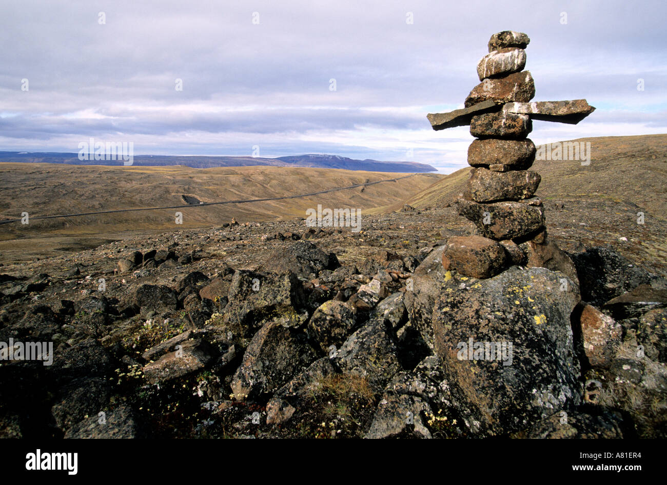 Canada, Nunavut, an inuit cairn on the road between Nanisivik and Victor Bay on Baffin Island - Stock Image