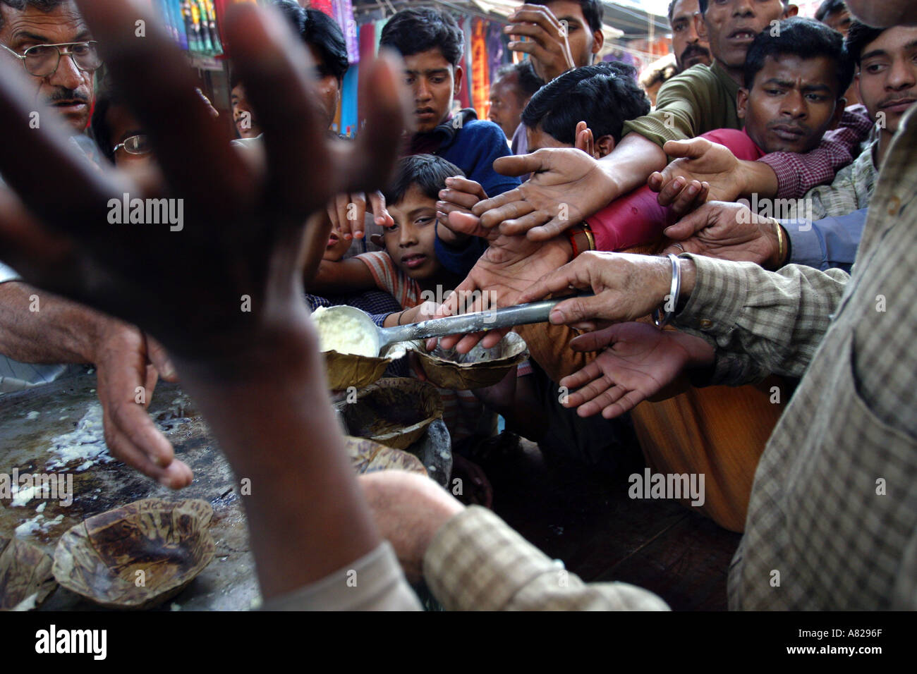A stand where food is given away for free to poor people at a street in Delhi India - Stock Image