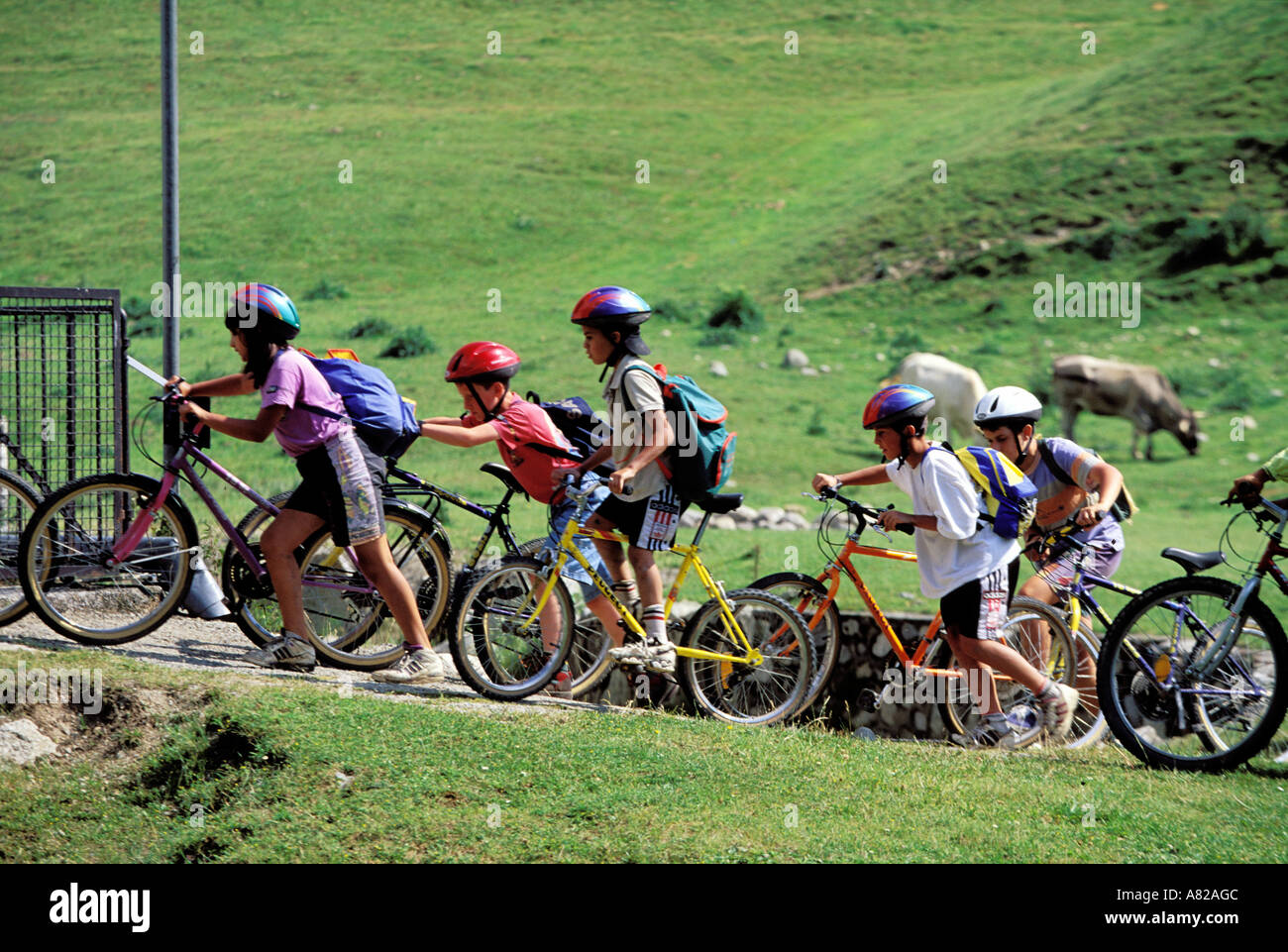 France, Hautes Pyrenees, CHILDREN RIDING THEIR BICYCLES Stock Photo