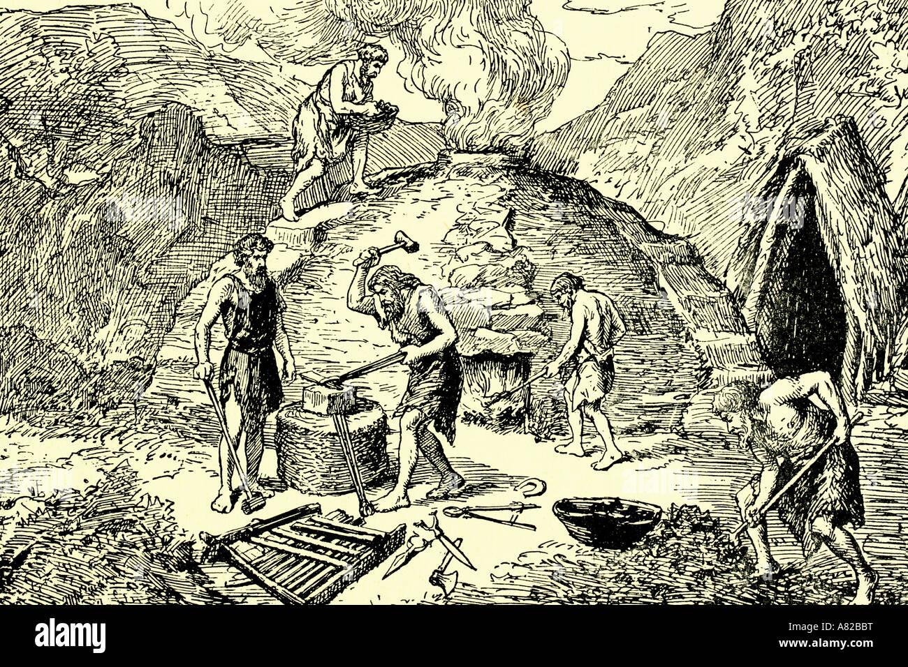 Iron age. Primitive men forging iron. Antique illustration. 1924 ...