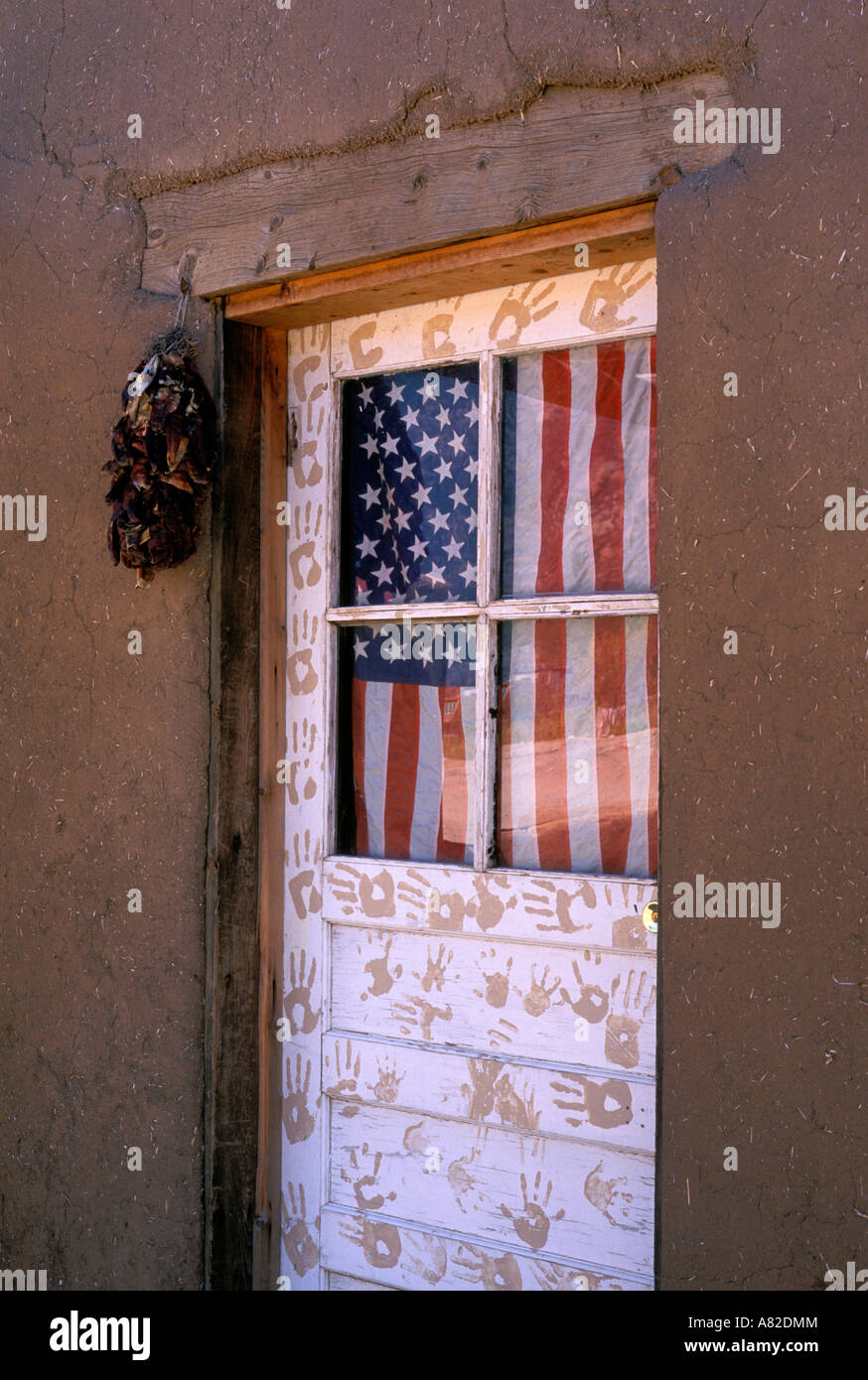 American flag and hand prints on the door of an adobe house Taos Pueblo New Mexico & American flag and hand prints on the door of an adobe house Taos ...