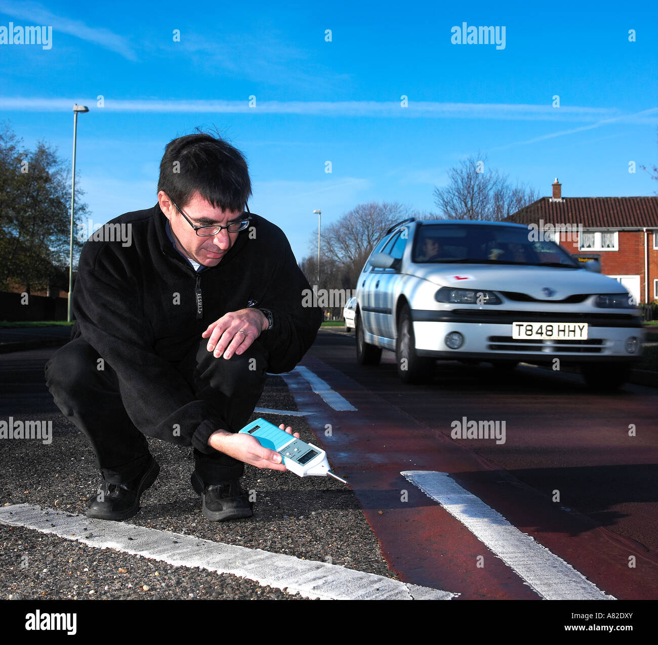 Inspector measuring road noise levels Stock Photo: 11965394