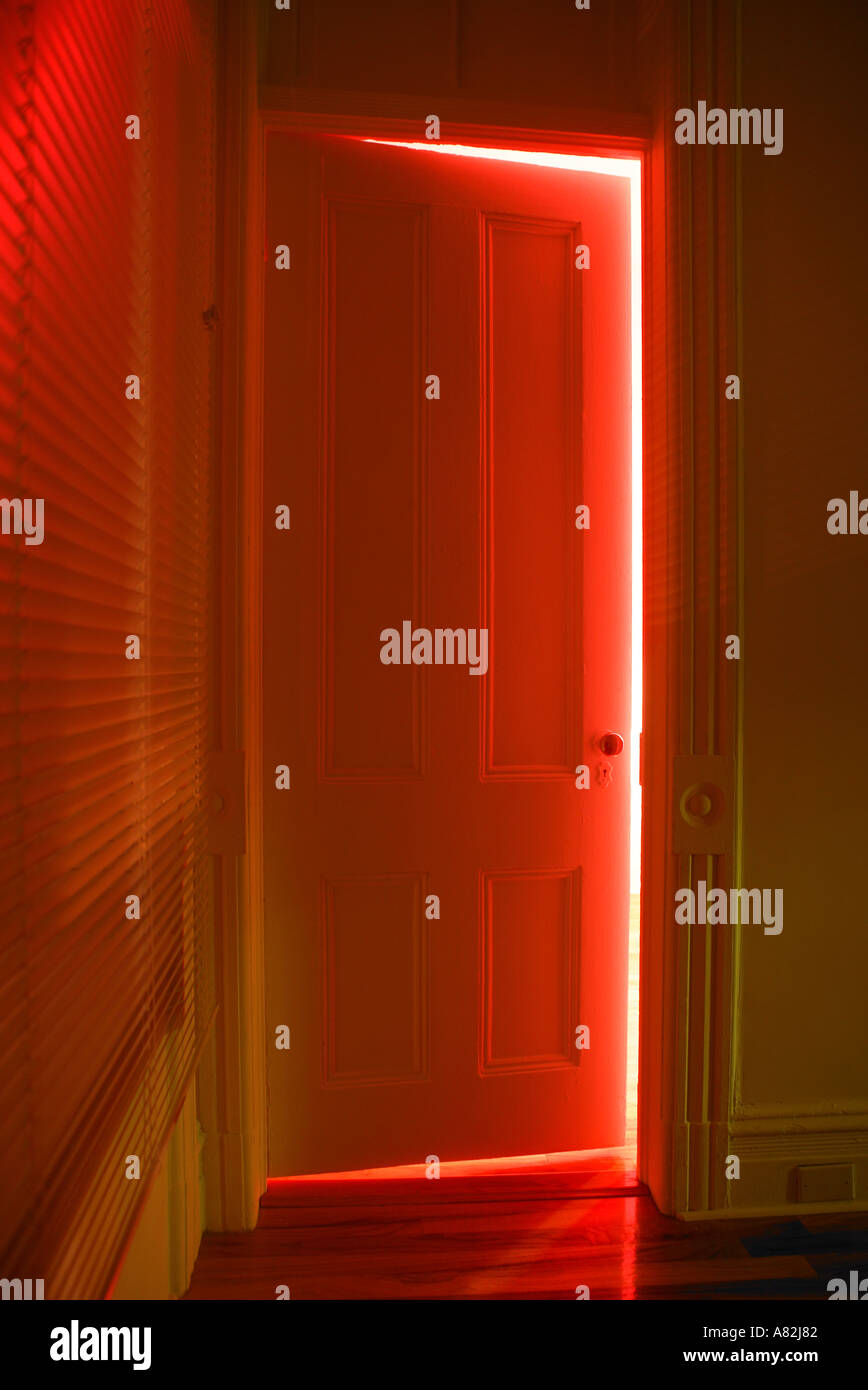Superbe Red Light Shining Through Half Open Door