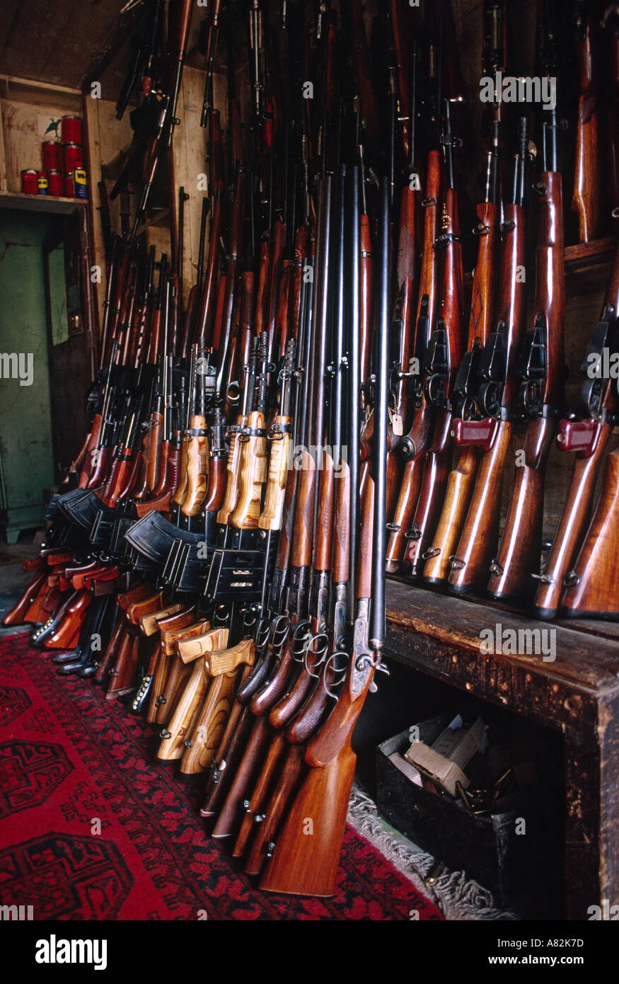 Pakistan NWFP Darra Adam Khel interior of shop selling locally made guns - Stock Image