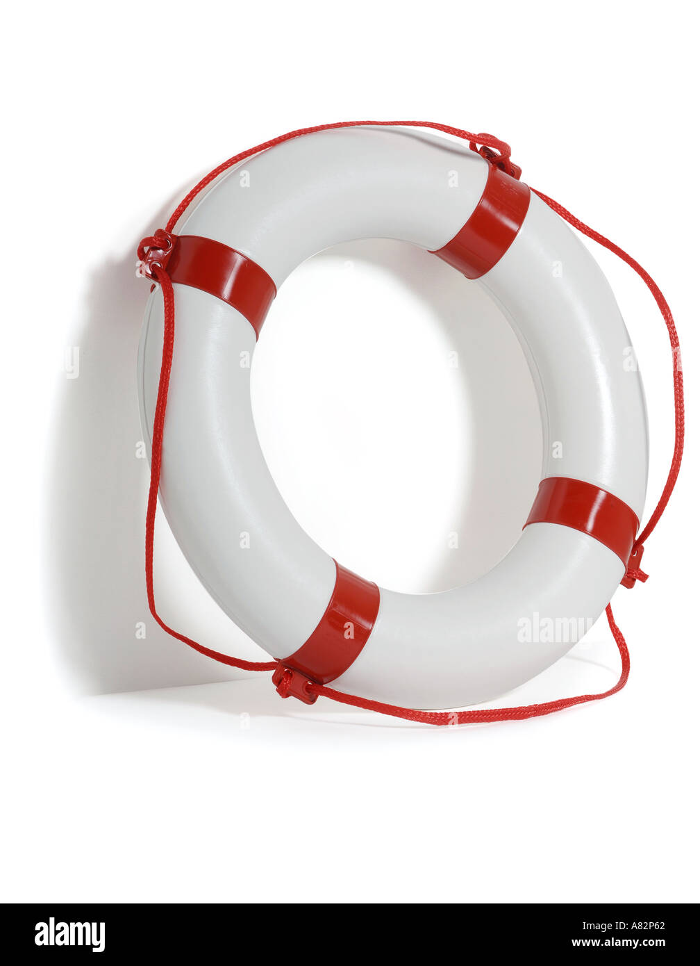 Red and white life ring against white background with shadow