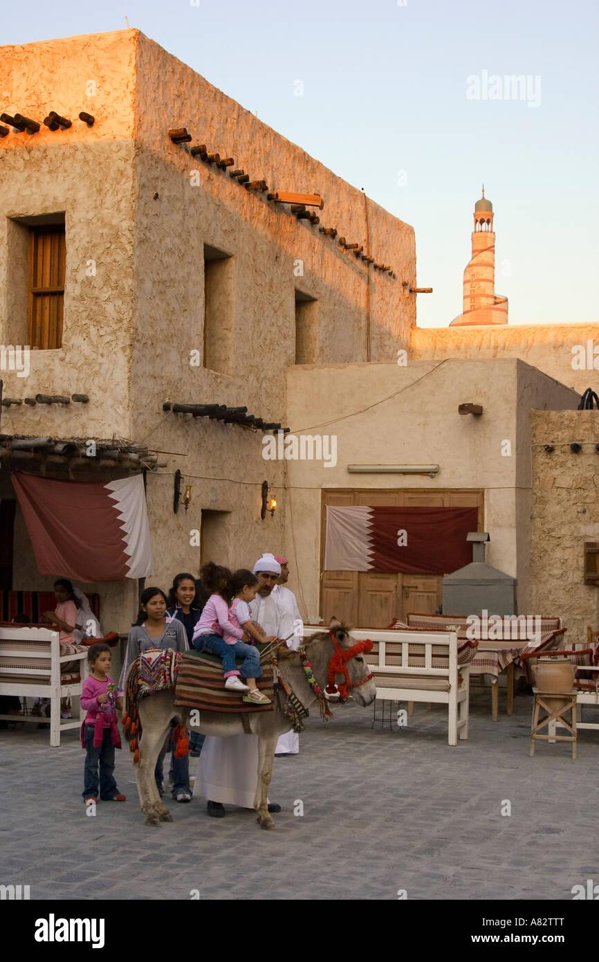 Qatar Doha Souk children on donkey Stock Photo