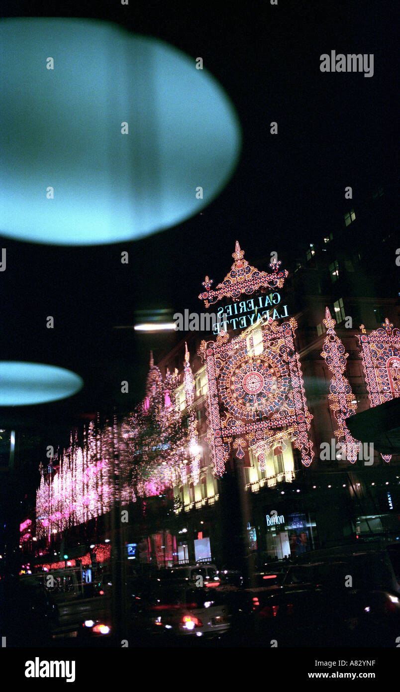 France, Paris, department stores illuminated on Haussmann boulevard during the Christmas festivals - Stock Image