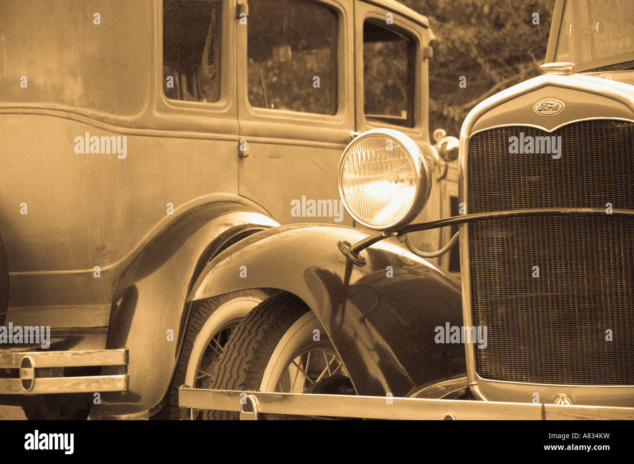 A couple of automobiles from the early 1930s; full description below. - Stock Image